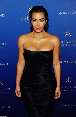 On point: Sporting her trademark bold brows and lashings of mascara, Kim looked in better shape than ever