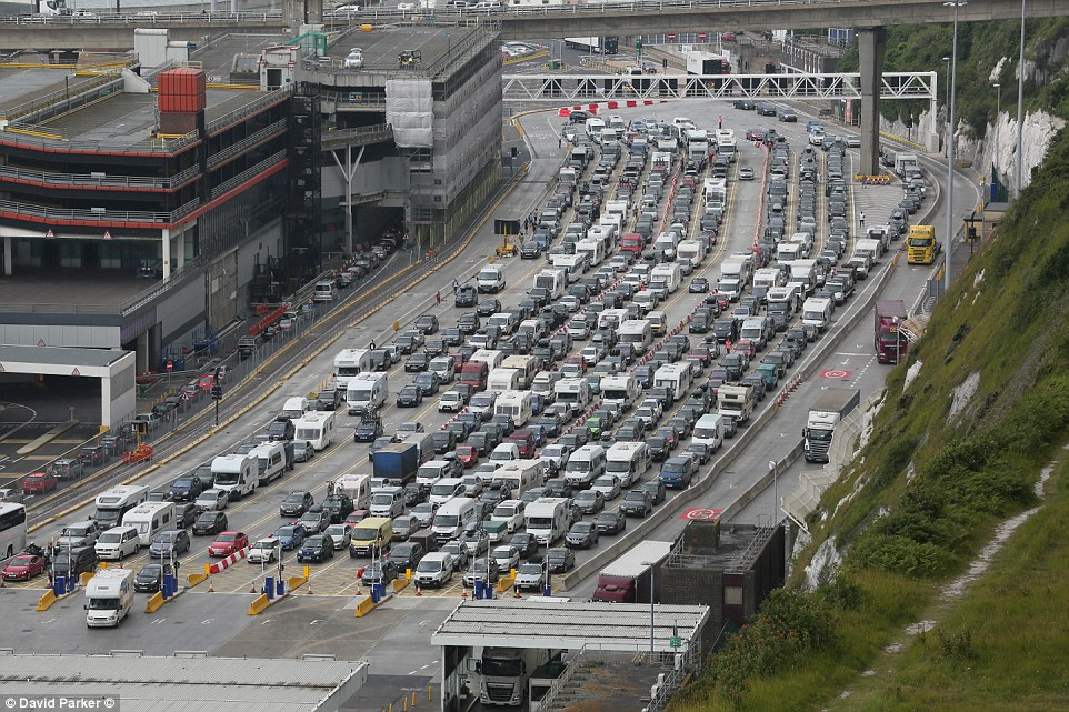 Thousands of motorists were still caught up in the huge traffic jam by the port on Sunday morning (pictured)