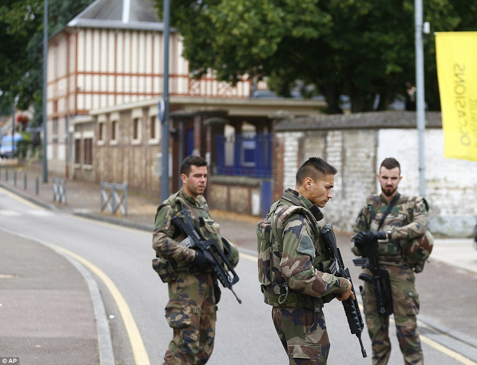 Lock down: The area was cordoned off and soldiers were called to the scene as a search for explosives got underway at the church today