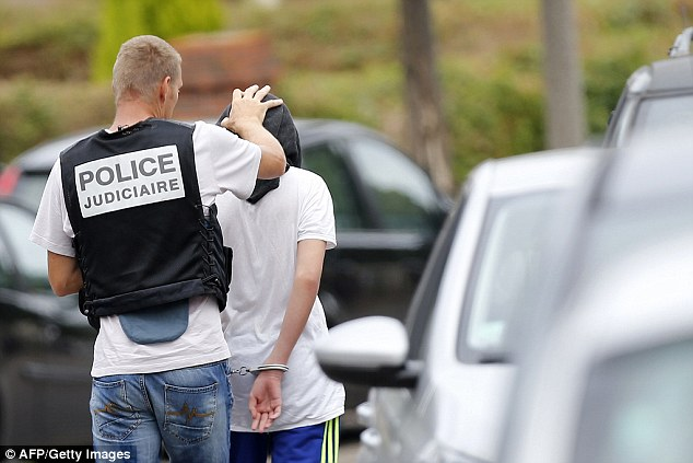 This afternoon, a third man was arrested in connection with the attack after police raided a house near the church