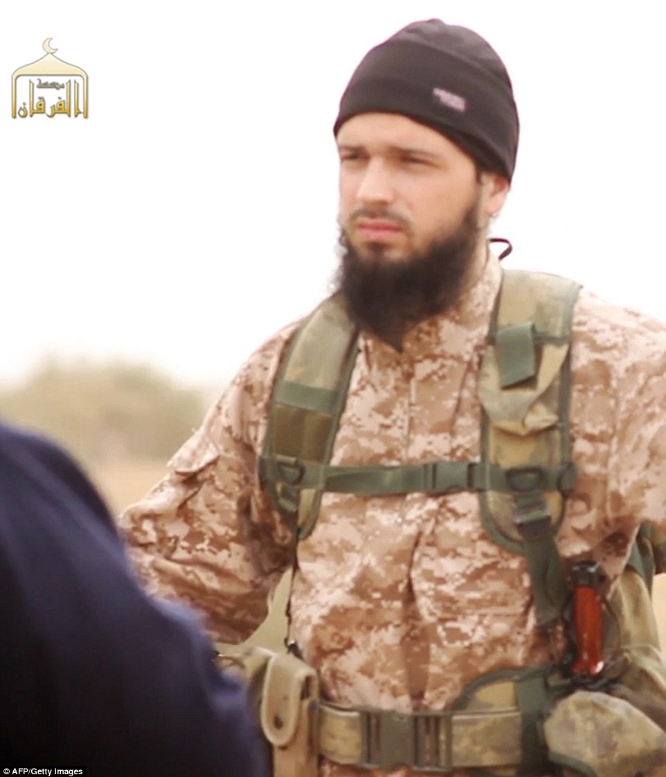 Normandy attacker Adel Kermiche was knownto have been a friend of Maxime Hauchard (pictured in a video that showed the beheading of Americans in Syria), a French jihadi involved in the beheading of Americans in Syria