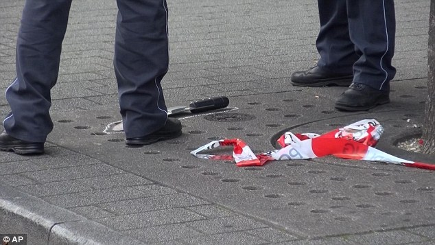 Police mark out the area where the attacker dropped the machete which he used to murder Jolanta and injure two others