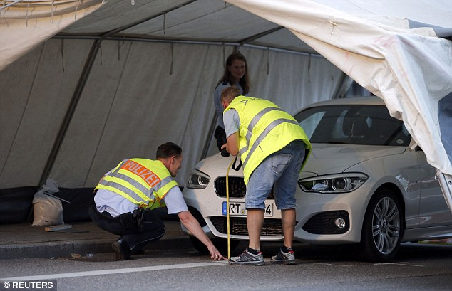 Police were also seen searching a car, which is believed to have hit the attacker as he fled the scene