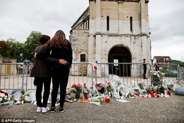 The UK's terror threat level is currently 'severe' ¿ the second highest level ¿ amid warnings that a jihadist atrocity is 'highly likely'. Pictured, mourners at the Saint-Etienne-du-Rouvray church attacked this week