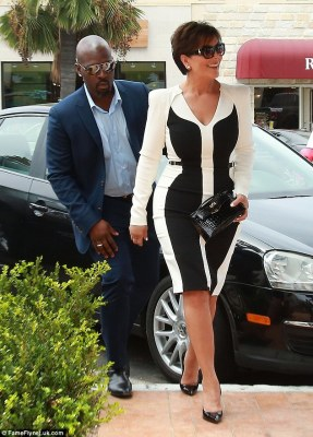 All business: The momager looked elegant in a black and white long-sleeved dress and shiny black stilettos