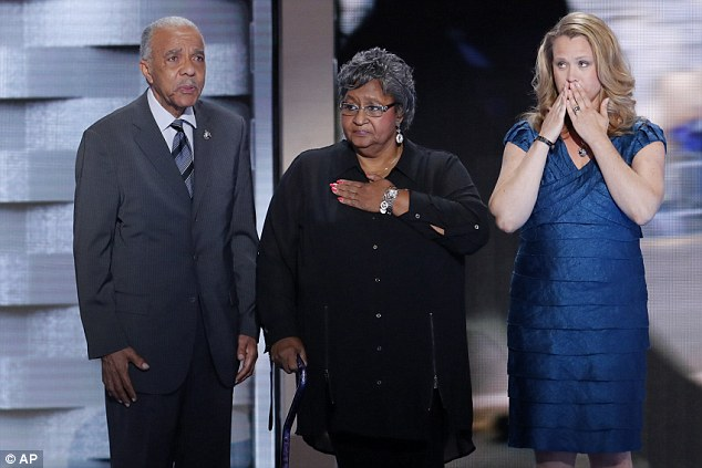 Wayne Owens, Barbara Owens and Jennifer Louden, family members of fallen law enforcement officers stand on the stage during the final day of the Democratic National Convention in Philadelphia