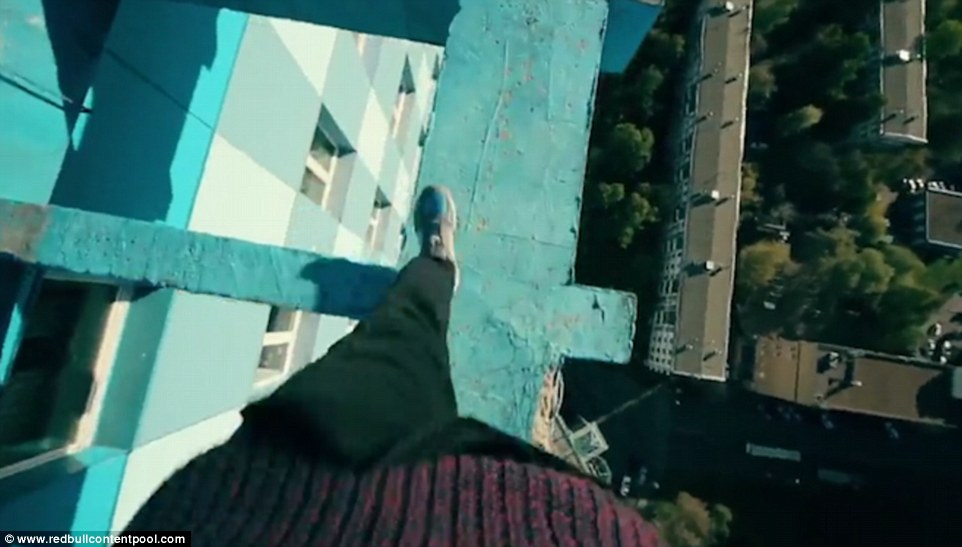 The footage introducing the Red Bull series shows Oleg walking across the beams of a bright blue residential building in Moscow