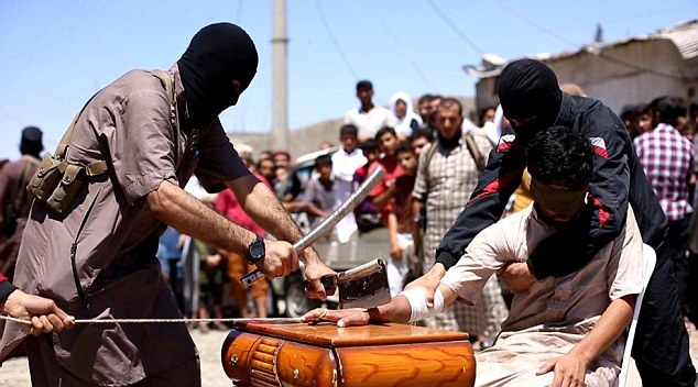 Sickening pictures show the moment ISIS thugs maimed a 'thief' for life by chopping off his hand with a cleaver while a crowd watched on