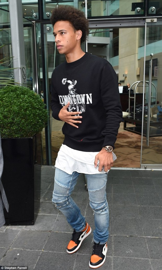 Leroy Sane leaves the Radisson Hotel in Manchester city centre on Monday morning