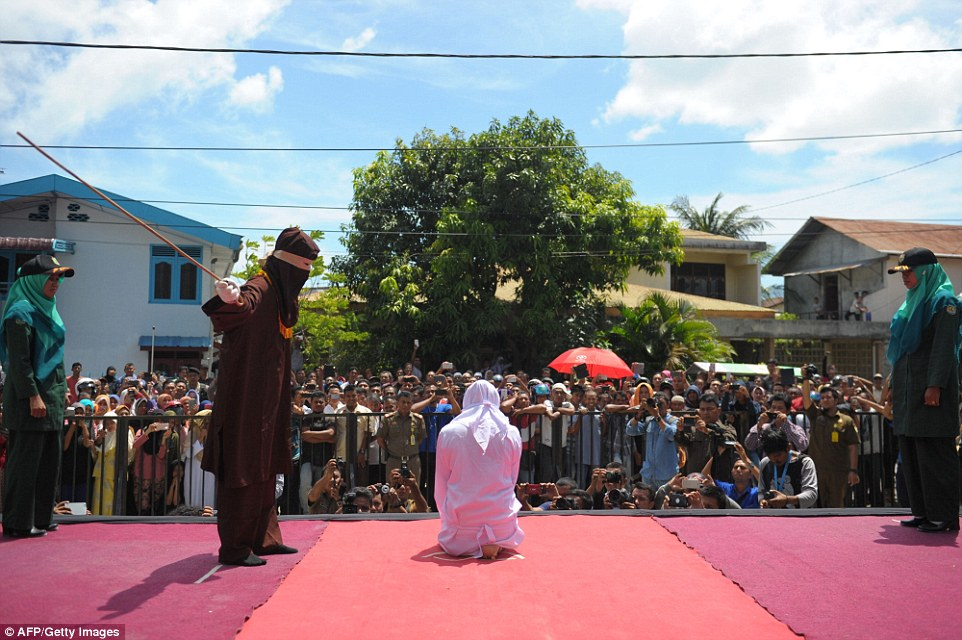 A large crowd gathered to watch religious officers deliver the sentence of lashes.Aceh has become increasingly conservative in recent years and is the only one in Indonesia implementing Sharia law
