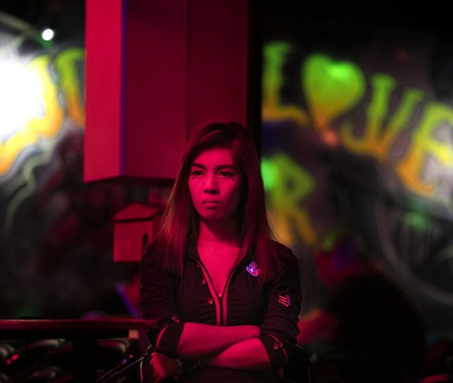 A Young Woman Waits For People At A Bar In Pattaya Thailand The Countrys