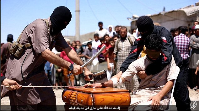 Brutality: A recent ISIS video shows Islamic State religious police reportedly chopping off the hand of an alleged thief in Raqqa, Syria