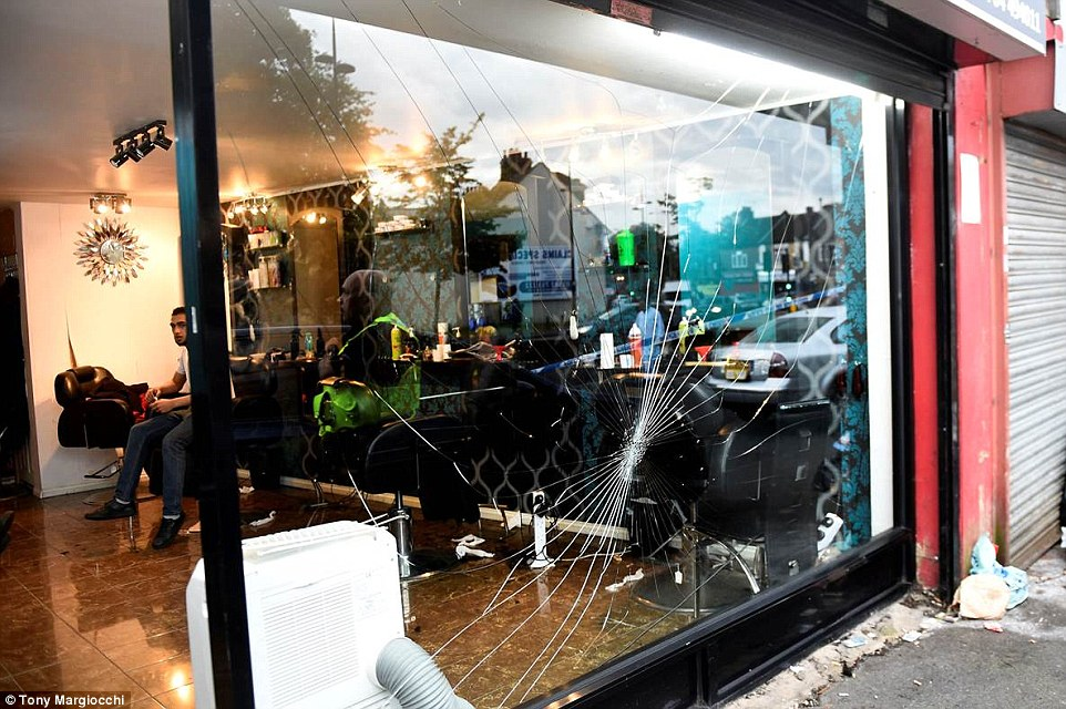 Owner Mohammad Abbas-Khan said one man received a bad head injury while the owner of the shop next-door was repeatedly beaten on the back so badly that two days later, he is still unable to move his arm