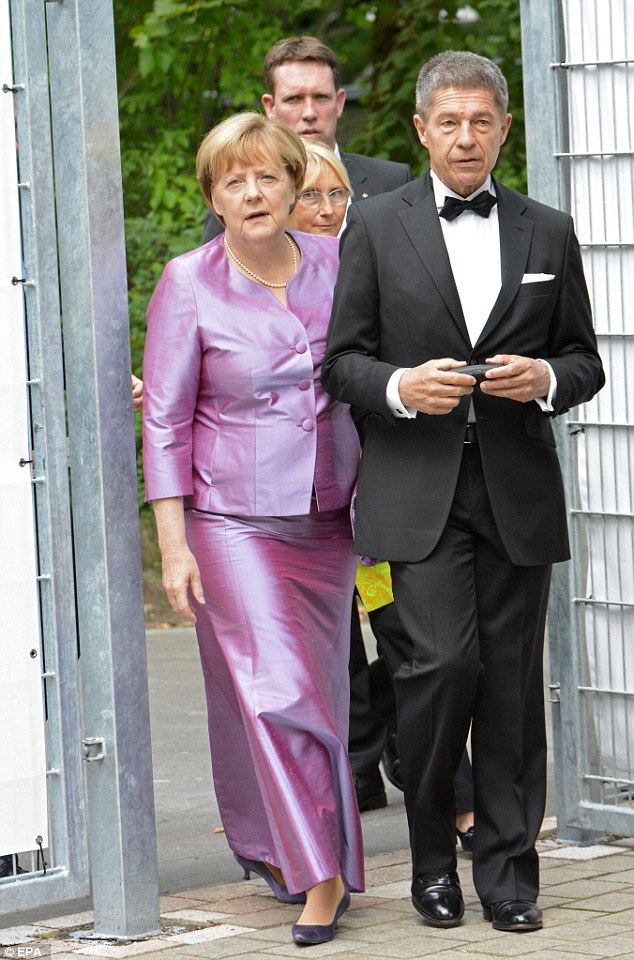 German Chancellor Angela Merkel and her husband Joachim Sauer arrive for Wagner's opera 'Tristan and Isolde' at the Bayreuth Festival, in Bayreuth, Germany, on Monday
