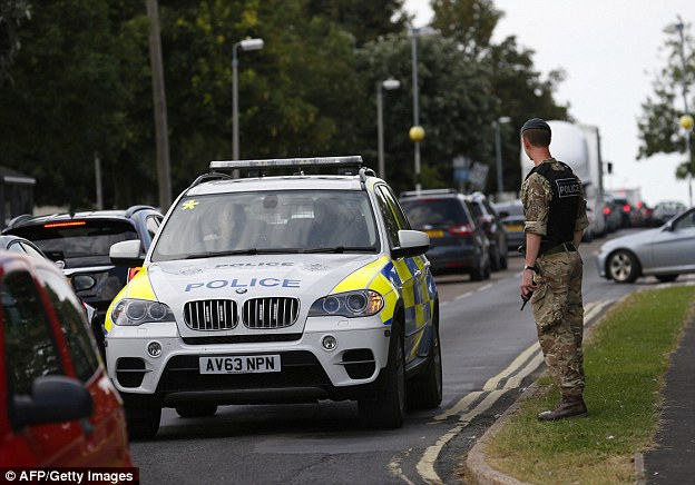 Police have received more than 150 calls from the public – but none have been confirmed sightings of the pair. Pictured are military police outside RAF Marham after the attack