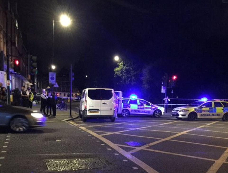 Police confirmed a man was arrested after he was seen 'brandishing a knife' and 'injuring people' in front of horrified onlookers in Russell Square last night. Pictured: A heavy police presence remained at the scene overnight due to the incident