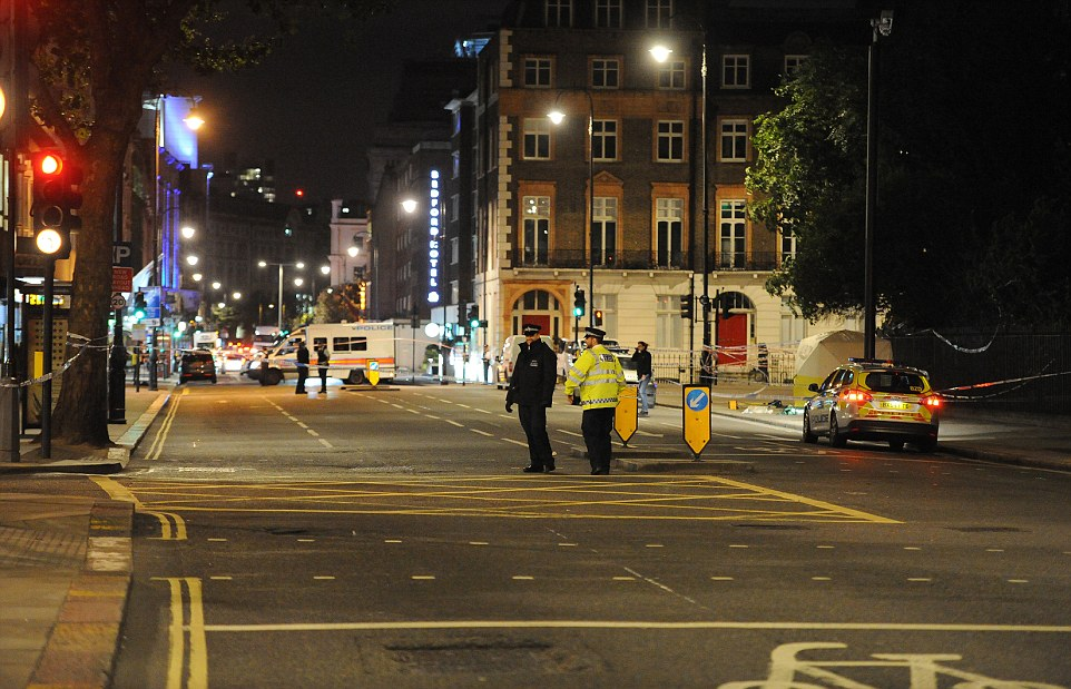 Police officers are seen patrolling the scene in Russell Square after the possible 'terror-related' mass stabbing last night
