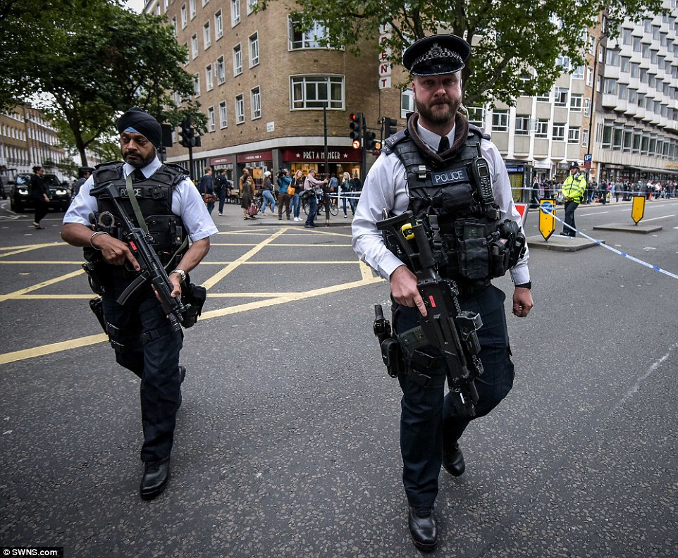 Ring of steel: Scotland Yard has sent dozens of armed officers on to the streets yesterday, including on Russell Square, pictured, to reassure the public - and protect if there is any other incident