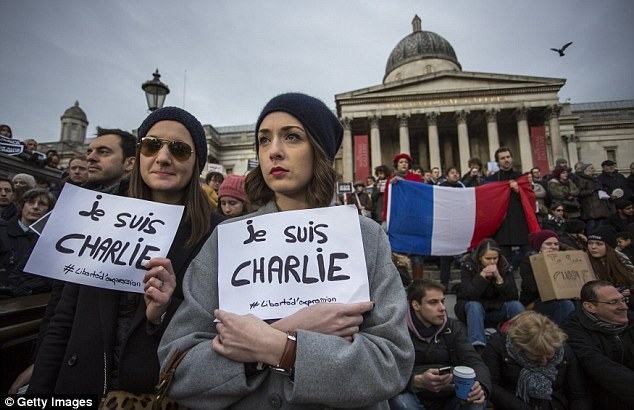Mourad was the brother-in-law of Cherif Kouachi, who carried out the murders at Charlie Hebdo with his brother Said Kouachi (pictured: Mourners remember those who died)