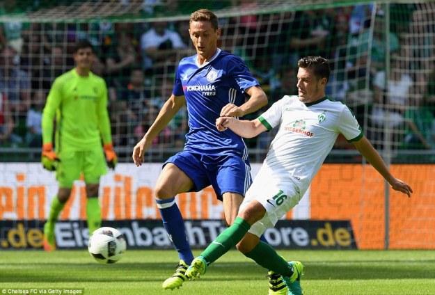 Nemanja Matic, who gave away the penalty for Werder Bremen's goal, attempting to tackle Bremen's Zlatko Junuzovic
