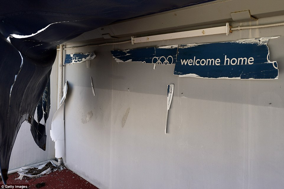 A sign emblazoned with the 2004 Athens Summer Games' motto 'Welcome Home' torn in half by vandals