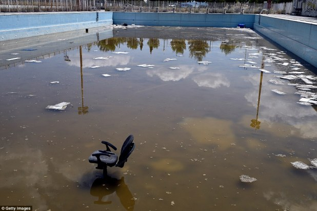 There are similar sites in Athens, Greece, with a swimming pool in the former Olympic Village filled with brown murky water, litter and a discarded office chair