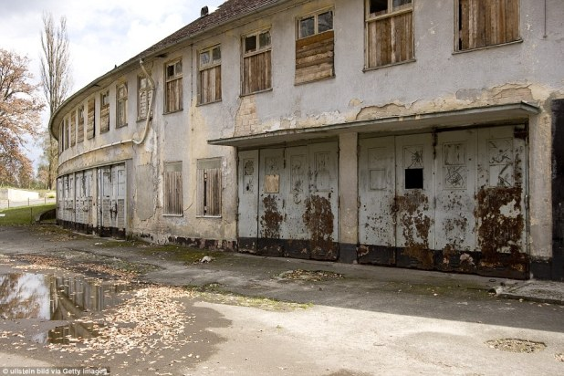 The athletes village from the 1936 Olympic Games in Germany has had the windows boarded with timber and sheets of plaster have been ripped from the walls of the deserted building