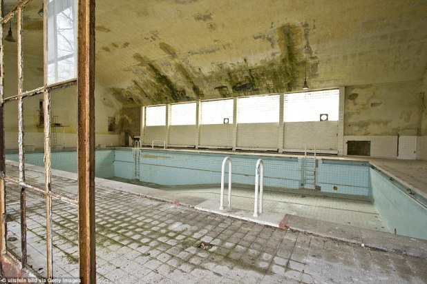 The pool next to the former athlete accommodation in Brandenburg, Germany, has been drained following the 1936 Berlin Games and rust and moss has begun to cover the floors and window panes