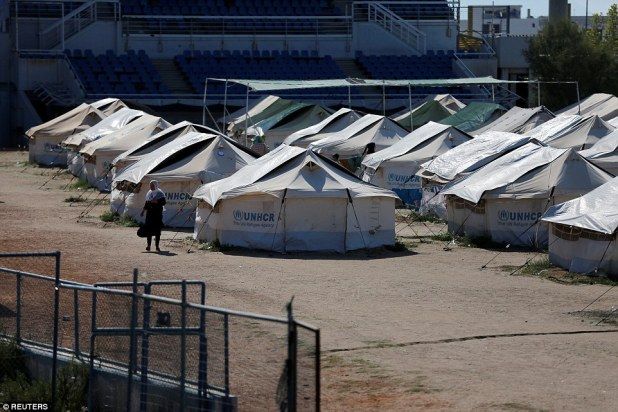 The old baseball venue at the former Hellenikon Olympic complex in Athens is now used as a shelter for refugees and migrants