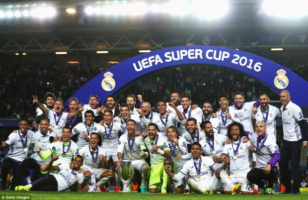 The Real Madrid players celebrate on Rosenborg's Lerkendal Stadium pitch after securing a European Super Cup triumph