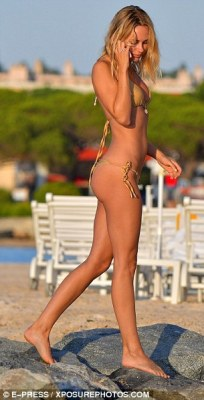 Cheeky! Kimberley made sure to have all eyes on her as she soaked up the sun in her racy swimwear