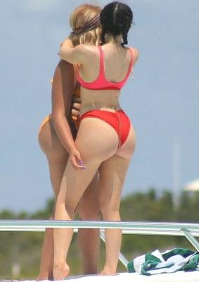 Say selfie! Kylie cuddled a pal while on a yacht