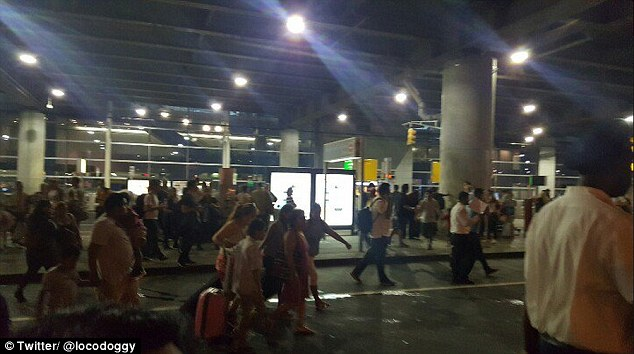 A massive police response has begun at the airport, in Queens, on Sunday evening
