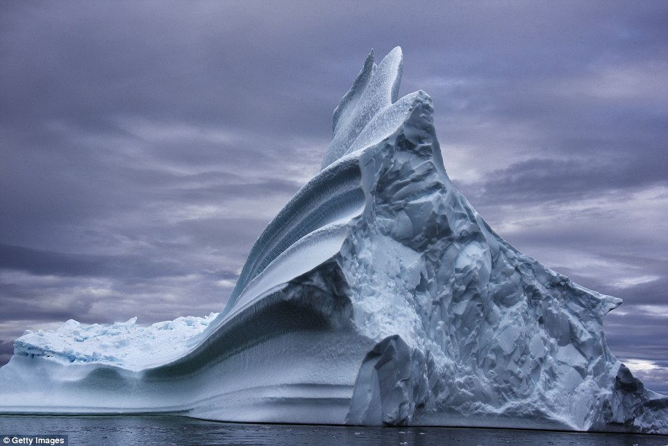 Whipped into grooved peaks by Greenland's stormy weather, this iceberg looks worthy of a carefully carved sculpture