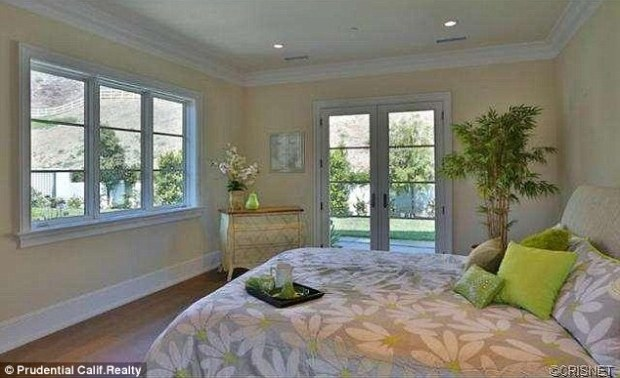 Great view: The windows and glass door give a wonderful perspective to the rolling hills and greenery