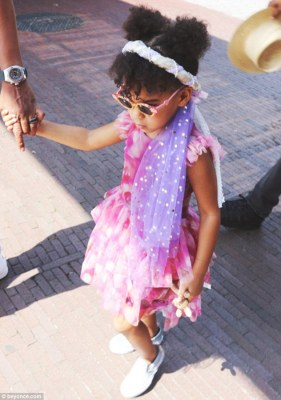 Sweetness personified: The impossibly cute little girl, whose dad is Jay z, was delightful in a pink tulle dress with a white headband and purple sparkly veil and her hair in pigtails