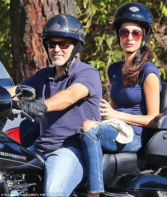 Easy rider: George Clooney took wife Amal for a spin on his motorbike along Mulholland Drive in Los Angeles on Friday