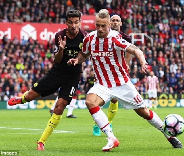 Jesus Navas Of Manchester City And Marko Arnautovic Of Stoke City Battle For Possession