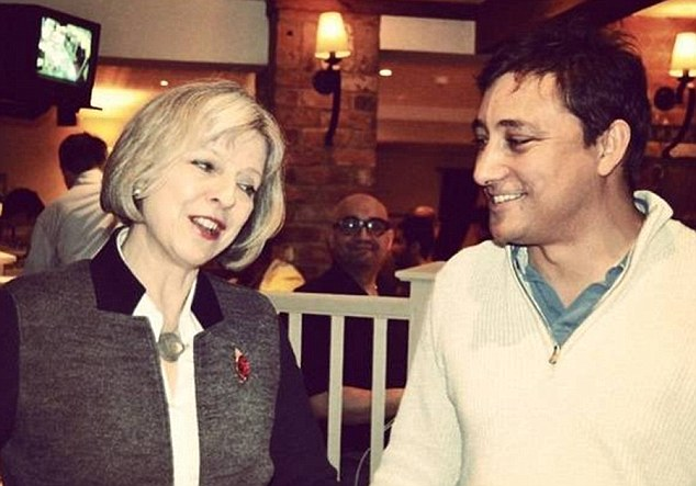 The Prime Minister can be seen slapping smiling Mark Clarke on the back and praising his work for the Conservatives at a boozy rally
