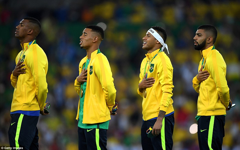 A range of emotions across the face of the Brazil side as they stand and sing their national anthem
