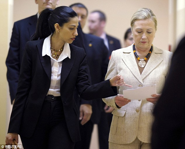 Secret agent? Donald Trump advisor Roger Stone is asking whether longtime Hillary Clinton (left) aide Huma Abedin (right) is a 'Saudi spy' or a 'terrorist agent'