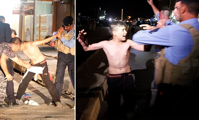 ISIS child suicide bomber is stripped of his explosives belt in Iraq by security forces