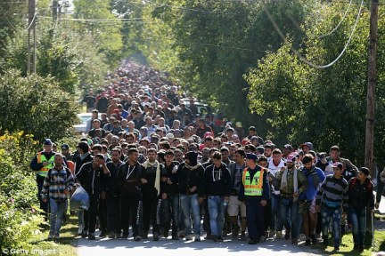 Jean-Claude Juncker called for all borders across Europe to be opened, despite the chaos caused over the last year from the flood in refugees fleeing Syria (hundreds of migrants pictured at the Hungarian and Austrian border last year)