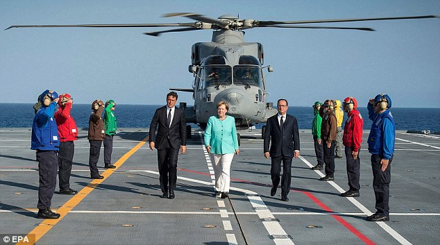 Mr Renzi, Mrs Merkel and Mr Hollande arrive for a meeting on a ship near Ventotene island