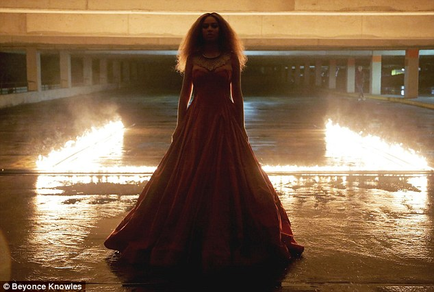 This girl is on fire: Her silhouette could be seen in front of a burning background