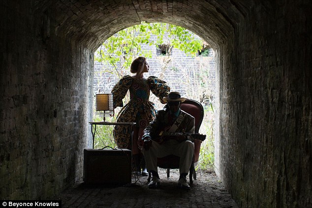 Victorian: She could be seen in a retro dress while posing at the end of a tunnel