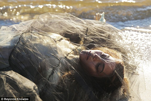 Uncomfortable: The mother of Blue Ivy posed while wrapped up in see-through material