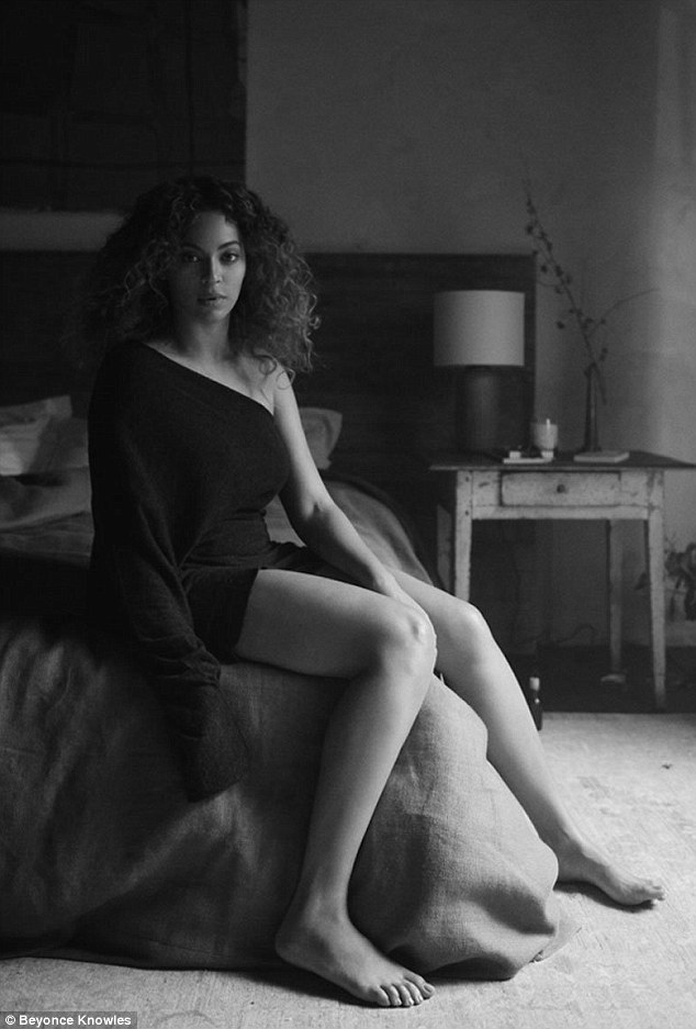 Gorgeous: She sat on the corner of a bed in a sultry snap
