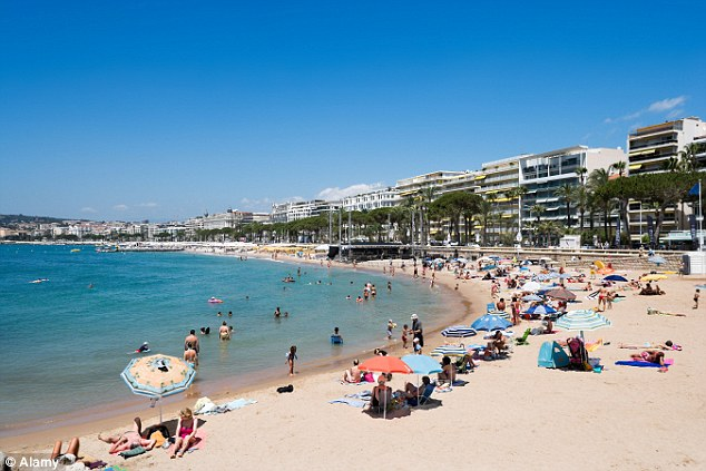 A young mother was ordered off Cannes beach and fined on Tuesday for wearing a headscarf (file photo). She was not wearing a burkini, which has recently been banned in Cannes