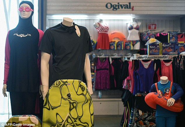 A burkini full-body swimsuit (left) designed for Muslim women is seen at a shopping mall in Kuala Lumpur